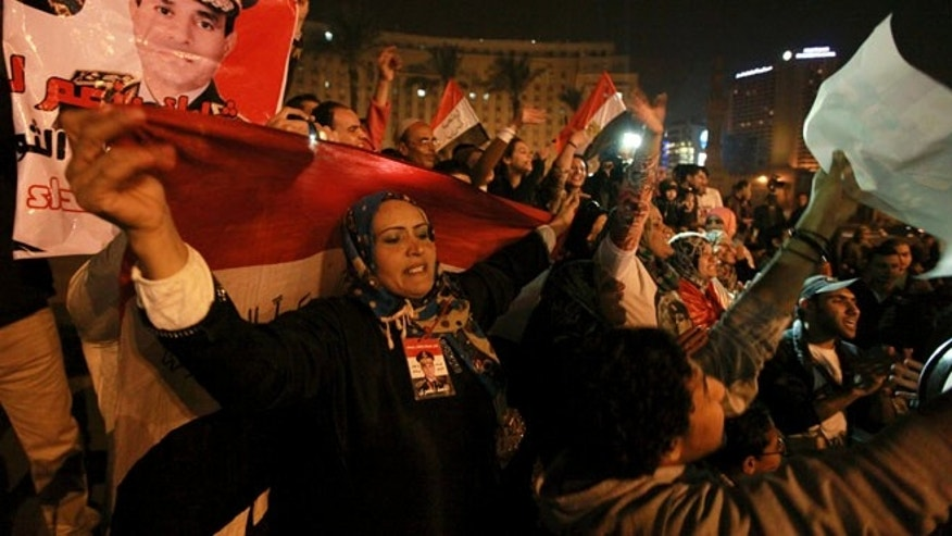 Jan. 18, 2014: Holding national flags and portraits of military chief  Gen. Abdel-Fattah el-Sissi, Egyptians celebrate the passage of a new constitution after 98.1 percent of voters supported Egypt's military-backed constitution in a two-day election, in Tahrir Square, Cairo, Egypt.