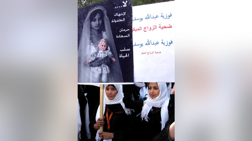 "FILE - In this Tuesday, March 23, 2010 file photo, Yemeni school students hold up posters denouncing child marriage, as they take part in a protest outside the parliament in Sanaa, Yemen. In the Middle East, Saudi Arabia and Yemen are the only Arab countries that do not have laws that set a minimum age for marriage. According to a December 2011 Human Rights Watch report, approximately 14 percent of girls in the Arab world's poorest nation of Yemen were married before the age 15, and 52 percent were married before 18 years old. Arabic reads, ""no for killing childhood "" and ""Fawzya Abdullah: a victim of underage marriage."" (AP Photo, File)"