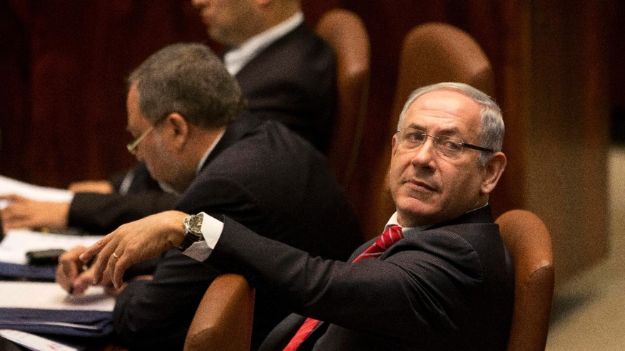 Israeli Prime Minister Benjamin Netanyahu listens while Canadian Prime Minister Stephen Harper speaks at Knesset, Israel's Parliament in Jerusalem, Monday, Jan. 20, 2014. (AP Photo/Ariel Schalit)