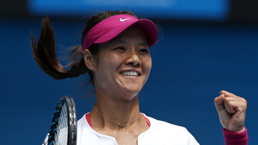 Li Na of China celebrates after defeating Flavia Pennetta of Italy during their quarterfinal at the Australian Open tennis championship in Melbourne, Australia, Tuesday, Jan. 21, 2014. (AP Photo/Aaron Favila)