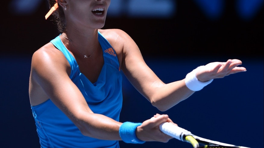 Ana Ivanovic of Serbia disputes a point as she plays Eugenie Bouchard of Canada during their quarterfinal at the Australian Open tennis championship in Melbourne, Australia, Tuesday, Jan. 21, 2014.(AP Photo/Andrew Brownbill)