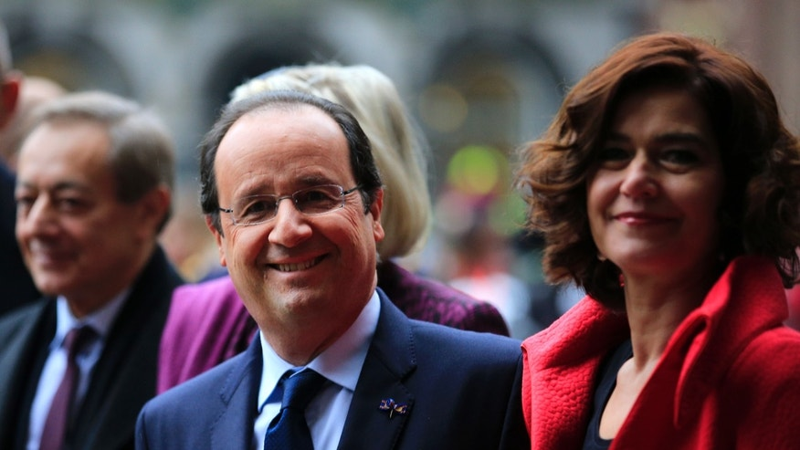 French President Francois Hollande poses for a photo with parliament president Anouchka van Miltenburg prior to a meeting in The Hague, Netherlands, Monday Jan. 20, 2014. (AP Photo/Peter Dejong)
