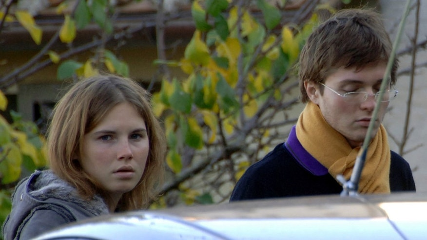 Nov. 2, 2007 - FILE photo of Amanda Knox and Raffaele Sollecito, outside the rented house where 21-year-old British student Meredith Kercher was found dead in Perugia, Italy.