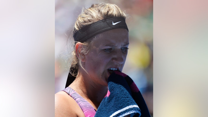 iVictoria Azarenka of Belarus bites a towel  a forehand during a break in her quarterfinal against Agnieszka Radwanska of Poland at the Australian Open tennis championship in Melbourne, Australia, Wednesday, Jan. 22, 2014.(AP Photo/Andrew Brownbill)