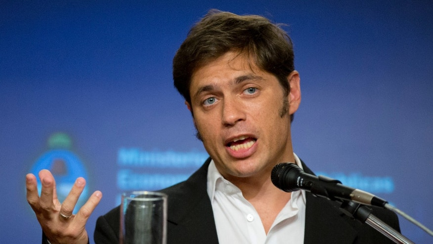 Economy Minister Axel Kicillof talks during a press conference in Buenos Aires, Argentina, Tuesday, Jan. 21, 2014. Kicillof informed about his meeting with Paris Club executives to discuss procedures regarding Argentina's debt which has not has not been payed since 2002. A Paris Club deal might reopen Argentina's access to credit insurance, loan guarantees and financing provided by the export credit agencies of Paris Club members. (AP Photo/Natacha Pisarenko)