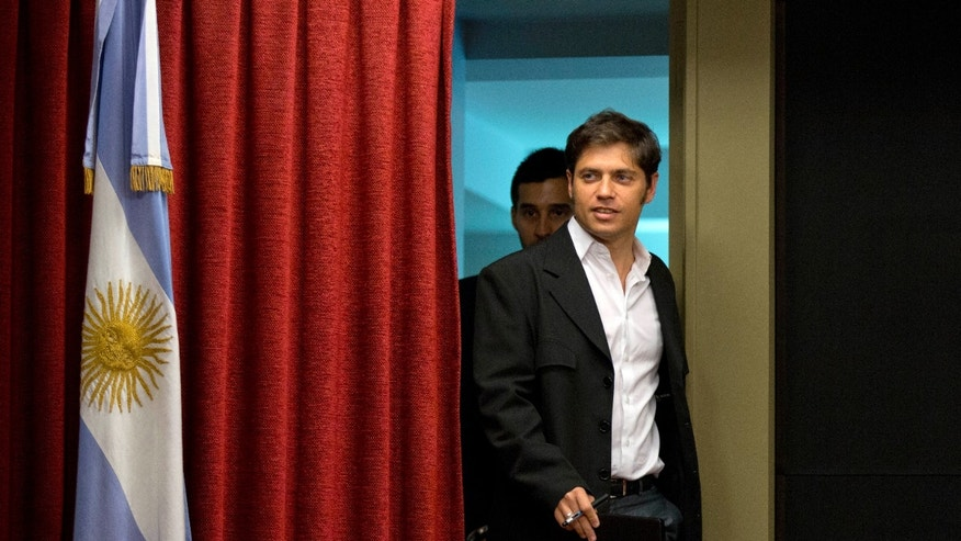 Economy Minister Axel Kicillof enters to address a press conference in Buenos Aires, Argentina, Tuesday, Jan. 21, 2014. Kicillof informed about his meeting with Paris Club executives to discuss procedures regarding Argentina's debt which has not has not been payed since 2002. (AP Photo/Natacha Pisarenko)
