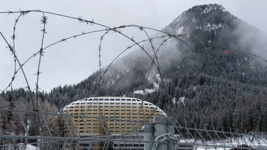 "The new InterContinental Hotel is pictured through the barbed wire, on the eve of the opening of the 44. annual Meeting of the World Economic Forum, WEF, in Davos, Switzerland, Tuesday, Jan.  21, 2014. The overarching theme of the Meeting, which will take place from 22 to 25 January, is ""The Reshaping of the World: Consequences for Society, Politics and Business"". (AP Photo/Keystone,Jean-Christophe Bott)"