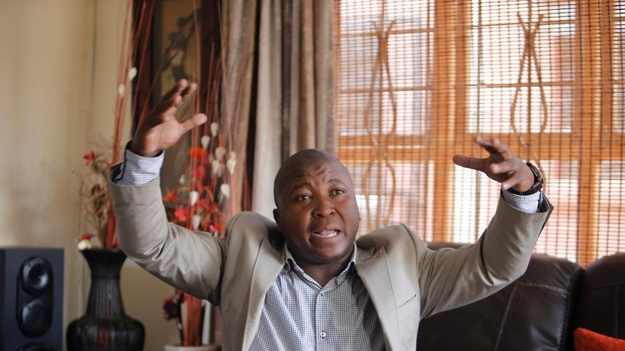 Dec. 12, 2013: Thamsanqa Jantjie gesticulates at his home during an interview with the Associated Press in Johannesburg, South Africa.
