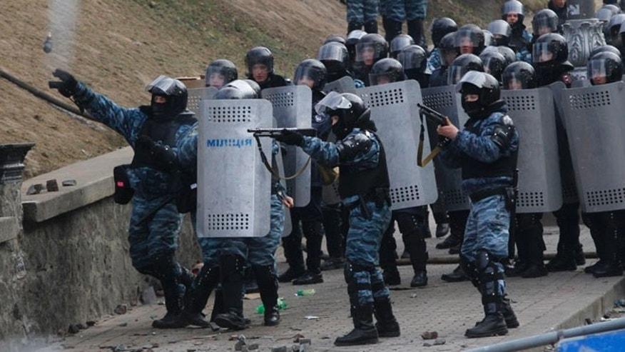 Jan. 20, 2014: Riot police officers shoot rubber bullets and throw a stun grenade at anti-government protesters, during unrest in central Kiev, Ukraine.
