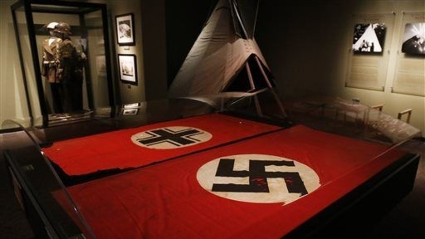 A Nazi German flag with the swastika.