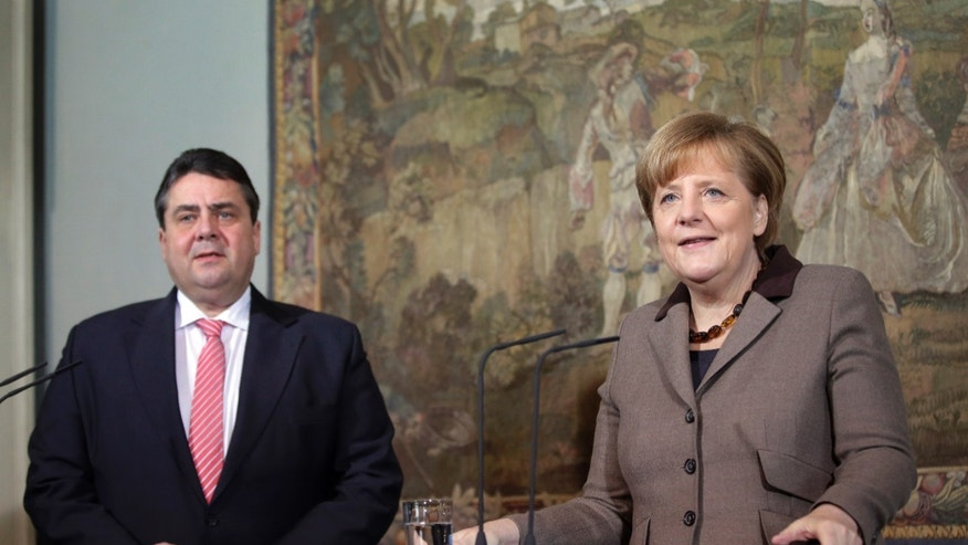 German Chancellor Angela Merkel, right, and German Economy and Energy Minister Sigmar Gabriel, left, address the media during a statement as part of a two day closed meeting of the German Government at the Meseberg palace near Berlin, Germany, Wednesday, Jan. 22, 2014. (AP Photo/Michael Sohn)