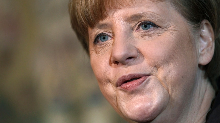 German Chancellor Angela Merkel speaks during a statement during a two day closed meeting of the German Government at the Meseberg palace near Berlin, Germany, Wednesday, Jan. 22, 2014. (AP Photo/Michael Sohn)