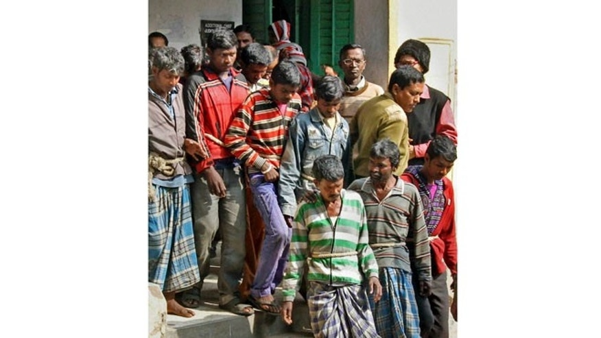 Jan. 23, 2014: Thirteen men arrested in the Monday night gang rape of a woman are produced at a court in Bolpur, West Bengal state, India.
