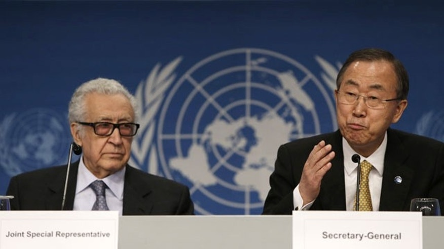 January 22, 2014: United Nations Secretary General Ban Ki-moon, right, speaks during a joint news conference with UN-Arab League Envoy to Syria Lakhdar Brahimi in Montreux, Switzerland. (AP)