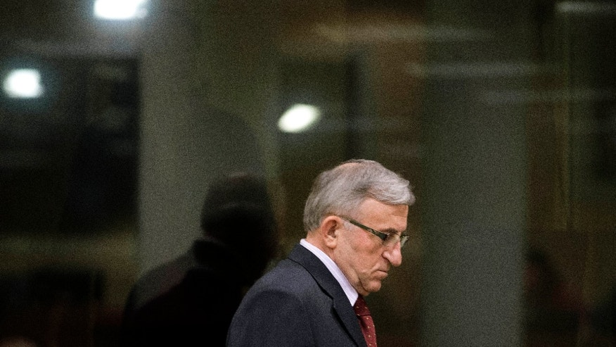 Vladimir Lazarevic enters the Yugoslav war crimes tribunal courtroom in The Hague Thursday, Jan. 23, 2014. Nikola Sainovic, Nebojsa Pavkovic, Sreten Lukic, and Vladimir Lazarevic, four former high-ranking Yugoslav and Serbian political, military and police officials who were convicted in 2009 for crimes committed against Kosovo Albanians in 1999 during Serbia's deadly crackdown on ethnic Albanians appeared in court at the Yugoslav war crimes tribunal ahead of a decision in their appeal. (AP Photo/Peter Dejong, Pool)