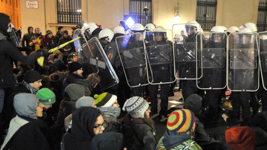 Demonstrators are  stopped by police as they gather to oppose a  ball being hosted at the Hofburg palace by the right-wing FPOE party, Friday, Jan. 24, 2014, in downtown Vienna, Austria. (AP Photo/Hans Punz)