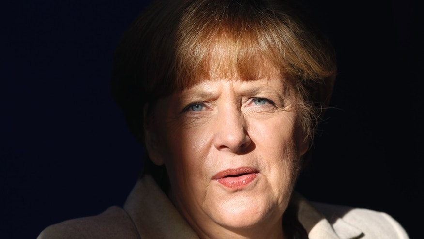 German Chancellor Angela Merkel arrives for a press conference after a cabinet meeting as part of a two day closed meeting of the German government at the Meseberg palace near Berlin, Germany, Thursday, Jan. 23, 2014. (AP Photo/Michael Sohn)