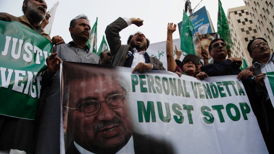 In this Thursday, Jan. 23, 2014 photo, supporters of Pakistan's former president and military ruler Pervez Musharraf rally in Karachi, Pakistan. A prosecutor and defense lawyer say Pakistan's former military ruler Pervez Musharraf who is facing a high treason case wants to be treated abroad for a heart disease. (AP Photo/Shakil Adil)