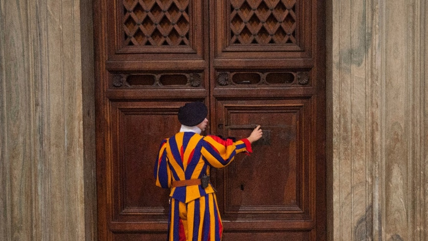 Jan. 14, 2014 - FILE photo:  A member of the Swiss Guard unlocks the door to the Sistine Chapel for Secretary of State John Kerry during a tour of the Vatican.