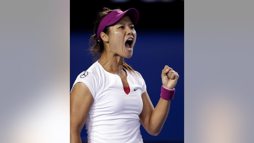 Li Na of China celebrates winning the first set over Dominika Cibulkova of Slovakia during their women's singles final at the Australian Open tennis championship in Melbourne, Australia, Saturday, Jan. 25, 2014.(AP Photo/Rick Rycroft)