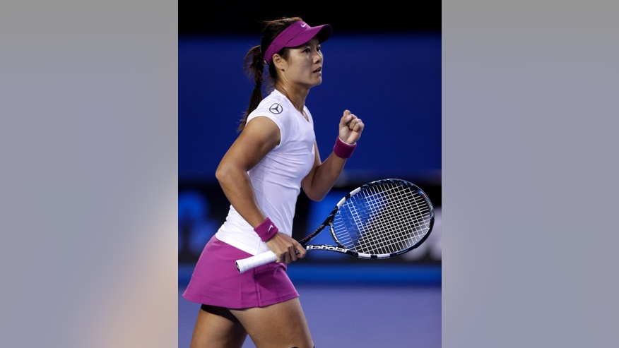 Li Na of China celebrates a point won against Dominika Cibulkova of Slovakia during their women's singles final at the Australian Open tennis championship in Melbourne, Australia, Saturday, Jan. 25, 2014.(AP Photo/Rick Rycroft)