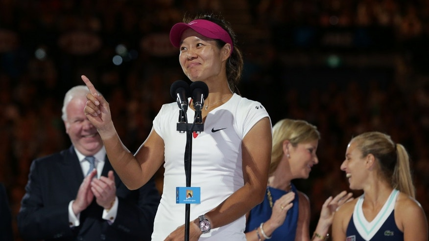 Li Na of China speaks after defeating Dominika Cibulkova of Slovakia, right,  in their women's singles final at the Australian Open tennis championship in Melbourne, Australia, Saturday, Jan. 25, 2014. (AP Photo/Aaron Favila)