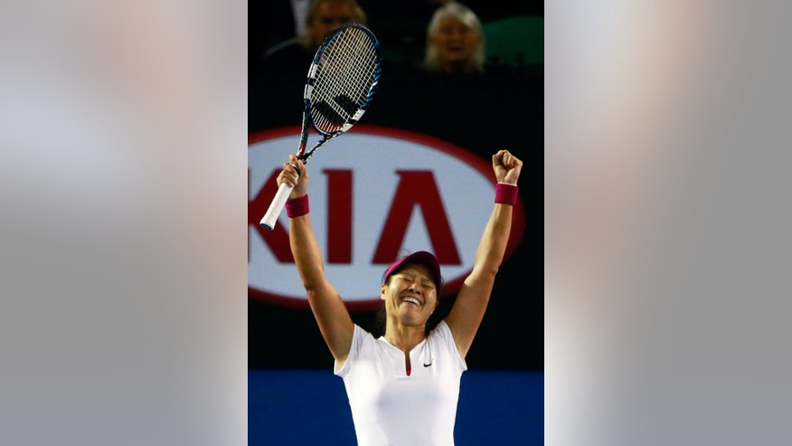 Li Na of China celebrates after defeating Dominika Cibulkova of Slovakia in their women's singles final match at the Australian Open tennis championship in Melbourne, Australia, Saturday, Jan. 25, 2014.(AP Photo/ Scott Barbour, Pool)