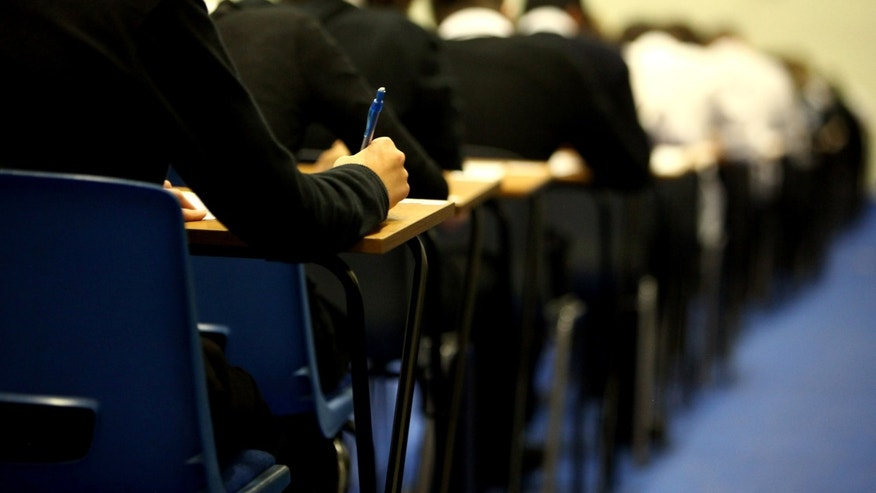 GLASGOW, UNITED KINGDOM - FEBRUARY 05: Pupils at Williamwood High School sit prelim exams on February 5, 2010 in Glasgow, Scotland As the UK gears up for one of the most hotly contested general elections in recent history it is expected that that the economy, immigration, the NHS and education are likely to form the basis of many of the debates. (Photo by Jeff J Mitchell/Getty Images)