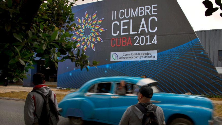 A sign announces the CELAC summit in Havana, Cuba, Friday, Jan. 24, 2014. Havana will host the meeting of Latin American and Caribbean leaders, January 28-29. (AP Photo/Ramon Espinosa)