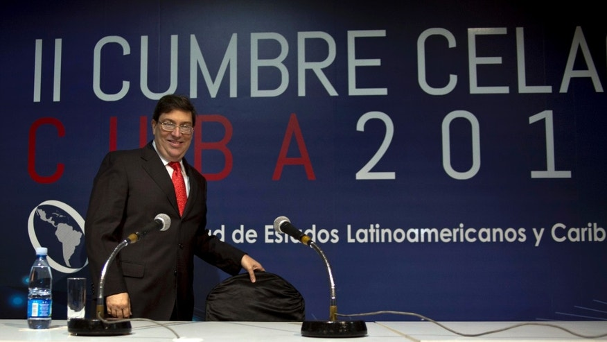 Cuba's Foreign Minister Bruno Rodriguez arrives to a press conference to inaugurate the press room set up for the upcoming CELAC summit in Havana, Cuba, Friday, Jan. 24, 2014. Havana will host the meeting of Latin American and Caribbean leaders, January 28-29. (AP Photo/Ramon Espinosa)