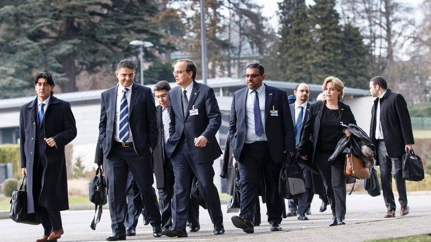 Syrian opposition chief negotiator Hadi Bahra,  front 3rd from left, returns  with his delegation after a break of the meeting, at the European headquarters of the United Nations, in Geneva, Switzerland, Saturday, Jan.  25, 2014. Two Syrian delegations, representatives of Syrian President Bashar  Assad and Syrian opposition, are meeting together with the Joint Special Representative.(AP Photo/Keystone,Salvatore Di Nolfi)