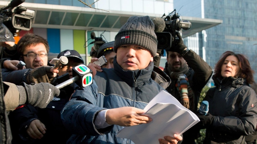 Zhang Qingfang, lawyer of legal scholar and founder of the New Citizens movement Xu Zhiyong, speaks to the media near the No. 1 Intermediate People's Court, in Beijing Sunday, Jan. 26, 2014. The Beijing court on Sunday sentenced Xu to four years in jail for disrupting order in public places, in a case that the U.S. government and other critics say is retribution against his push to fight corruption and create equal educational opportunities. (AP Photo/Andy Wong)