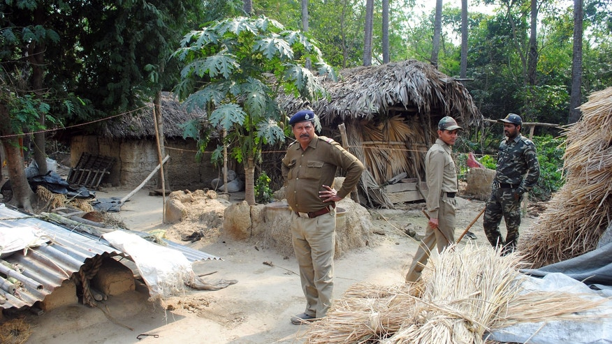 Policemen inspect the site where a woman was gang raped, allegedly on the direction of a village council at Subalpur village, in Birbhum district, about 180 kilometers (110 miles) north of Kolkata, the capital of the eastern Indian state of West Bengal, Friday, Jan. 24, 2014. The woman told police that Monday's attack came as punishment for falling in love with a man from a different community and religion. The case has brought fresh scrutiny to the role of village councils, common in rural Indian, which decide on social norms in the village. (AP Photo)