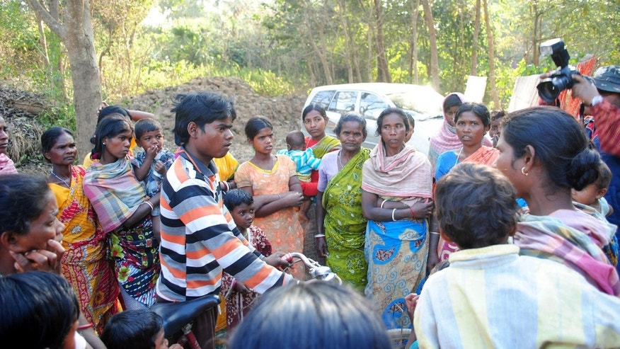 Santhal tribal women gather in a village where a woman was gang raped, allegedly on the direction of a village council at Subalpur, in Birbhum district, about 180 kilometers (110 miles) north of Kolkata, the capital of the eastern Indian state of West Bengal, Friday, Jan. 24, 2014. These unelected and unregulated courts now are coming under fresh scrutiny after police say a council of elders in West Bengal ordered the gang rape of a 20-year-old woman as punishment for falling in love with the wrong man. (AP Photo)