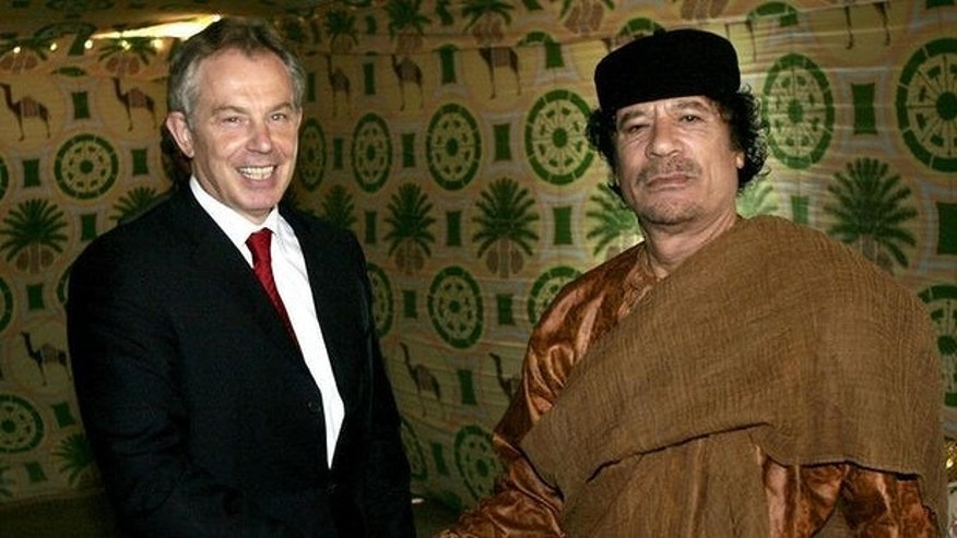 Former British Prime Minister Tony Blair and Libyan leader Muammar Qaddafi meet in 2007 (AP)