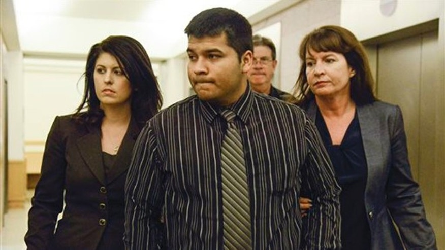 Erick Munoz, center, husband of Marlise Munoz is escorted by attorneys as he walks to 96th District Court Friday, Jan. 24, 2014 in Fort Worth, Texas.  A judge has ordered a Texas hospital to remove life support for a pregnant, brain-dead woman. Judge R. H. Wallace Jr. issued the ruling Friday in the case of Marlise Munoz. John Peter Smith Hospital in Fort Worth has been keeping Munoz on life support against her family's wishes. Munoz was 14 weeks pregnant when her husband found her unconscious Nov. 26, possibly due to a blood clot. (AP Photo/Tim Sharp)
