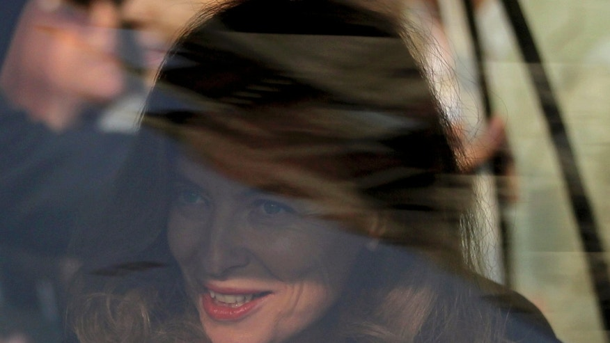 Valerie Trierweiler, the ex-first lady of French President Francois Hollande, smiles in a car as she leaves for Sion government hospital in Mumbai, India, Monday, Jan. 27, 2014. A day after splitting up with Hollande, Trierweiler launched a new stage in her life Sunday with a charity visit to India. (AP Photo/Rafiq Maqbool)