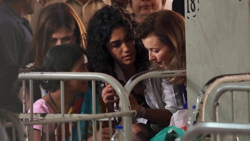 Valerie Trierweiler, right, the ex-first lady of French President Francois Hollande, speaks to a patient during her visit to Sion government hospital in Mumbai, India, Monday, Jan. 27, 2014. A day after splitting up with Hollande, Trierweiler launched a new stage in her life Sunday with a charity visit to India. (AP Photo)