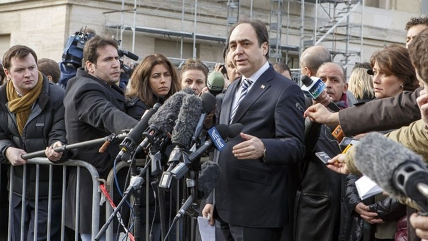 January 26, 2014: Monzer Akbik, a spokesman of the Syrian National Coalition, Syria's main political opposition group briefs the media, at the European headquarters of the United Nations, in Geneva, Switzerland. (AP Photo)