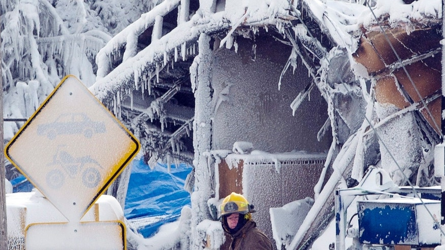 Emergency workers resume the search for victims at a fatal seniors residence fire, Sunday, Jan. 26, 2014, in L'Isle-Verte, Quebec. (AP Photo/The Canadian Press, Ryan Remiorz)