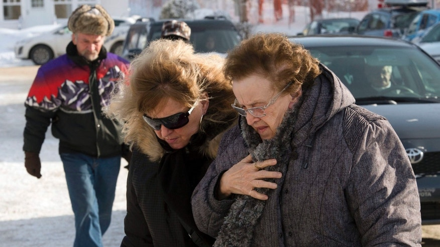 People arrive for a commemorative service for victims of last week's fatal fire at a seniors residence, Sunday, Jan. 26, 2014, in L'Isle-Verte, Quebec. (AP Photo/The Canadian Press, Ryan Remiorz)