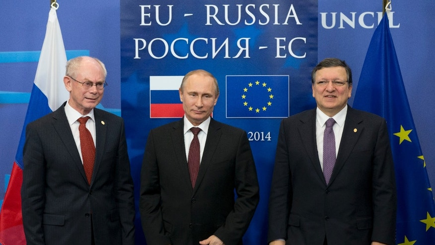 From the left, European Commission President Jose Manuel Barroso, Russian President Vladimir Putin and European Council President Herman Van Rompuy pose for a photo at the European Commission headquarters in Brussels, Belgium, Tuesday, Jan. 28, 2014. Russian President Vladimir Putin and European Union leaders are weighing the future of their common relationship at a summit that was abridged amid stark differences over Ukraine's future and other issues. (AP Photo/Alexander Zemlianichenko)