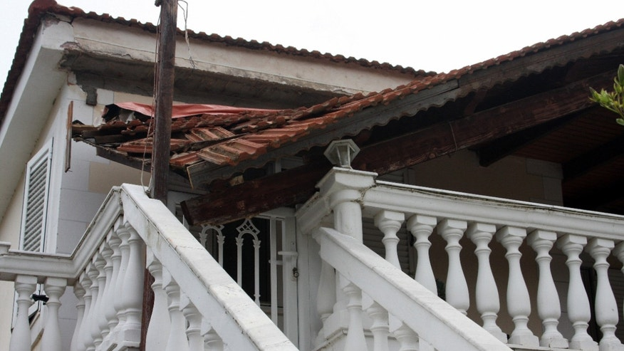 A section of a balcony roof is collapsed after an earthquake in Lixouri town on the island of Kefalonia, western Greece, Monday, Jan. 27, 2014. Greece's government on Monday announced emergency relief for the residents of the Ionian islands of Kefalonia and Ithaki, a day after they were hit by a strong quake which caused damage and slightly injured seven people. Sunday's quake has been followed by dozens of aftershocks that continued throughout the night and through Monday. (AP Photo/Giannis Soulis)