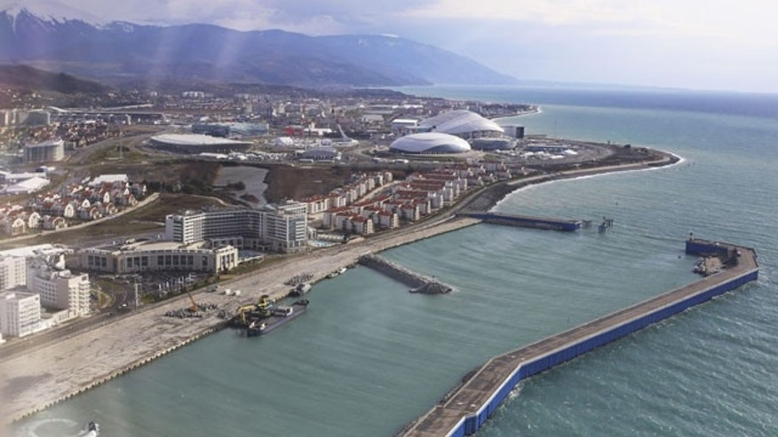 January 27, 2014: A view of the Olympic Park and seaside of the Russian Black Sea resort of Sochi. Russia has spent about $51 billion to deliver the Winter Olympics in Sochi, which run Feb. 7-23. (AP Photo/Pavel Golovkin)