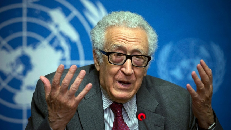 U.N. mediator for Syria Lakhdar Brahimi gestures during a press briefing at the United Nations headquarters in Geneva, Switzerland, Monday, Jan. 27, 2014. Syrians on opposite sides of their country's civil war tried again Monday to find common ground, with peace talks focusing on an aid convoy to a besieged city that once more came under mortar attack from the government. (AP Photo/Anja Niedringhaus)
