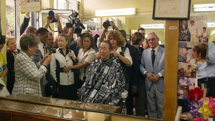 This photo released by the United Nations shows Secretary General ban Ki-moon getting an impromptu haircut at Solon Correo in Old Havana, Cuba Monday Jan. 27, 2014.  (AP Photo/United Nations, Mark Garten)