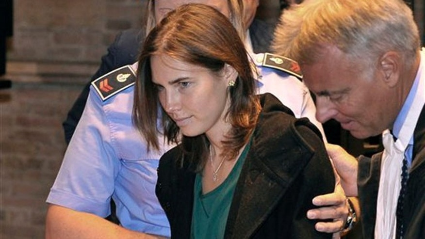 Amanda Knox, accompanied by her lawyer Carlo Dalla Vedova, arrives for an appeal hearing at the Perugia court, central Italy, Monday, Oct. 3, 2011. A tearful Amanda Knox has told an appeals court in Italy that accusations that she killed her British roommate are unfair and groundless. Knox fought back tears as she addressed the court Monday, minutes before the jury went into deliberations to decide whether to uphold her murder conviction. A verdict is expected later in the day. (AP Photo/Antonio Calanni)