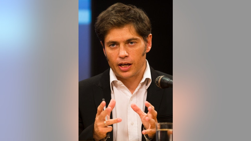 Argentine Economy Minister Axel Kicillof speaks during a news conference in Buenos Aires, Argentina, Wednesday, Jan. 29, 2014. Kicillof announced a deal with Argentina's largest retailers to the lower prices of consumer and household electronics that were raised during the recent currency devaluation. With Argentina's peso on its sharpest slide in 12 years, Argentines are dealing with one of the world's highest inflation rates. (AP Photo/Victor R. Caivano)