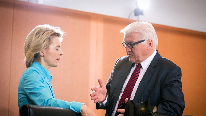 """FILE - In this Jan. 15, 2014 file photo German Minister of Defence Ursula von der Leyen, left, and German Foreign Minister Frank-Walter Steinmeier talk at the beginning of a cabinet meeting at the Federal Chancellery in Berlin, Germany. After years in the diplomatic shadows, Germany looks keen to shed its image as a foreign-policy lightweight and assume a more vigorous role in shaping European policies in global hotspots from central Africa to Syria. New Foreign Minister Steinmeier has declared that Europe """"cannot leave France alone"""" in Africa. He and von der Leyen are preparing to reinforce Germany's military role in Mali and help France at least logistically in Central African Republic. (AP Photo/dpa, Kay Nietfeld, File)"""