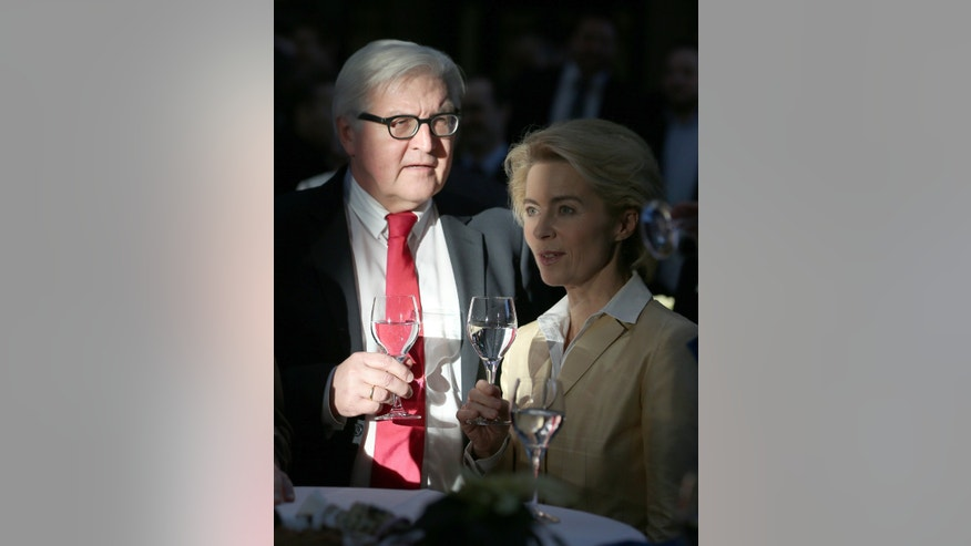 """FILE - In this Dec. 16, 2013 file photo then designated German Foreign Minister Frank-Walter Steinmeier, left, and then designated German Minister of Defence Ursula von der Leyen, stand next to each others after the signing of the coalition agreement  at the Paul-Loebe-Haus of the German 'Bundestag' parliament in Berlin, Germany. After years in the diplomatic shadows, Germany looks keen to shed its image as a foreign-policy lightweight and assume a more vigorous role in shaping European policies in global hotspots from central Africa to Syria. New Foreign Minister Steinmeier has declared that Europe """"cannot leave France alone"""" in Africa. He and von der Leyen are preparing to reinforce Germany's military role in Mali and help France at least logistically in Central African Republic. (AP Photo/dpa, Hannibal Hanschke, File)"""